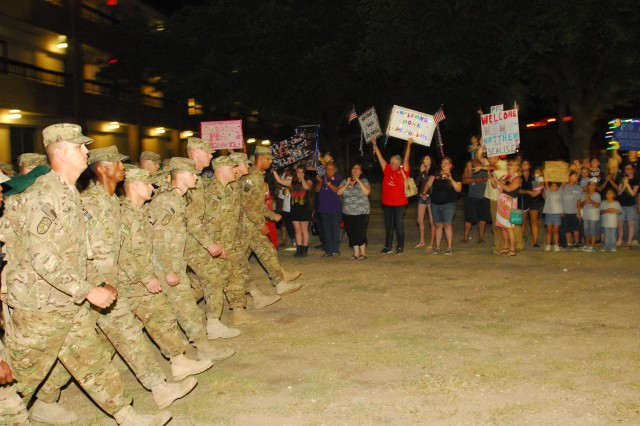 """FORT HOOD, Texas - Soldiers of 1-21st Field Artillery Battalion, 41st Fires Brigade """"Rail Gunners"""", march into the 1-21st Field Artillery Battalion headquarters area, to a round of applause from the gathering of families and friends, Sept. 1. The Rail Gunners have just returned from their deployment to Afghanistan where they provided transportation and security for NATO personnel in and around the Afghan capital city of Kabul."""