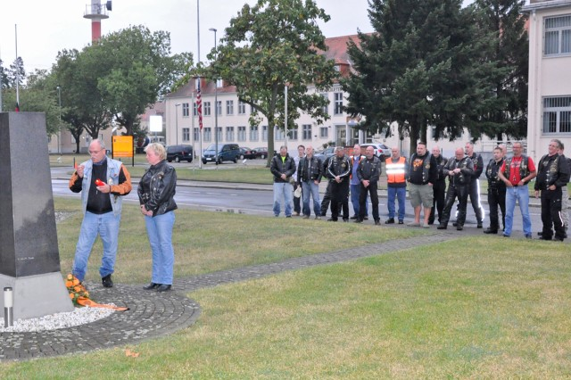 Members of the Wiesbaden-Nassau Harley Owners Group pay tribute at Wiesbaden Clay Kaserne's Veterans Park on Sept. 11, 2012.