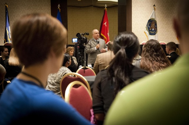Under Secretary of the U.S. Army Dr. Joseph W. Westphal visits soldiers and their families, Sept. 8, 2012, at an Army Reserve Yellow Ribbon Program event in Kansas City, Mo. Westphal met with some of the 700 participants and their children and stressed the Army's commitment to helping with transitional issues surrounding deployment. (U.S. Army photo by Staff Sgt. Bernardo Fuller)