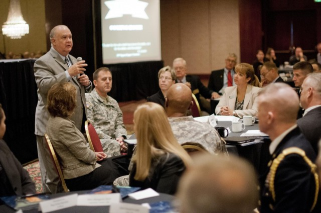 Under Secretary of the U.S. Army Dr. Joseph W. Westphal (standing); Maj. Gen. Glenn J. Lesniak (left of Westphal), deputy commanding general (support), U.S. Army Reserve Command; Brig. Gen. Tammy S. Smith (left of Lesniak), director of the Army Reserve Human Capital Core Enterprise; attend the Yellow Ribbon Program event, Sept. 8, 2012, in Kansas City, Mo. The distinguished visitors met with some of the 700 participants and their children. (U.S. Army photo by Staff Sgt. Bernardo Fuller)