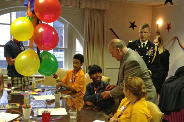 Under Secretary of the U.S. Army Dr. Joseph W. Westphal visits Soldiers and their families, Sept. 8, 2012, at an Army Reserve Yellow Ribbon Program event in Kansas City, Mo. Westphal met with some of the 700 participants and their children and stressed the Army's commitment to helping with transitional issues surrounding deployment. (U.S. Army photo by Randolph Belden)