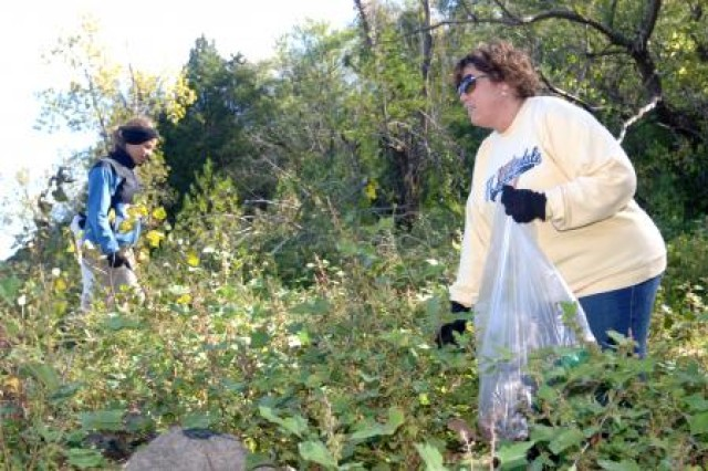 Amanda Burt (left) and Lisa Maxwell scour an area for litter and debris during a 2011 National Public Lands Day clean up event at Center Hill Lake, Tenn.