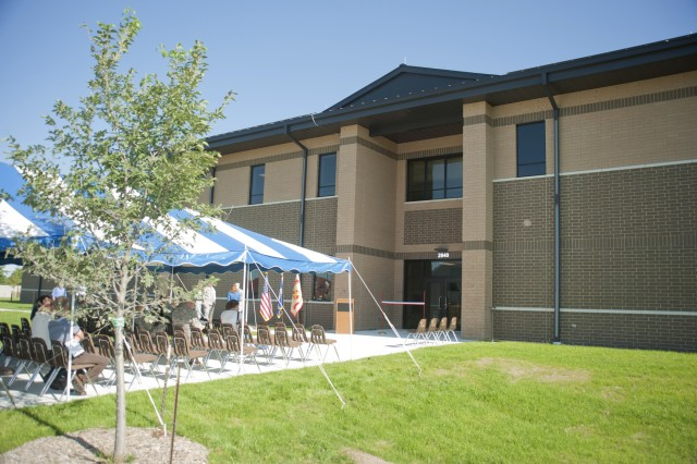 Guests at the ribbon-cutting ceremony for the new Annual Training/Mobilization Barracks view the outside of the facility.