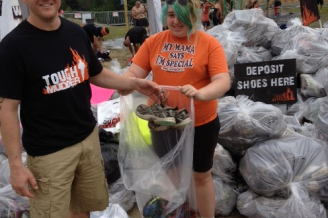 """The Tough Mudder organization, as does the Warrior Dash, takes your shoes when you are finished with the race, if you're willing to make the donation.  Tough Mudder cleans up each pair and sends them overseas to people in need, while the Warrior Dash grinds the shoes up and turns them into playground mulch.  """"I guess my old tired running shoes are better than nothing to someone,"""" said ERDC Deputy Commander Maj. Thomas Clair, a Tough Mudder 2012 and previous Warrior Dash participant."""