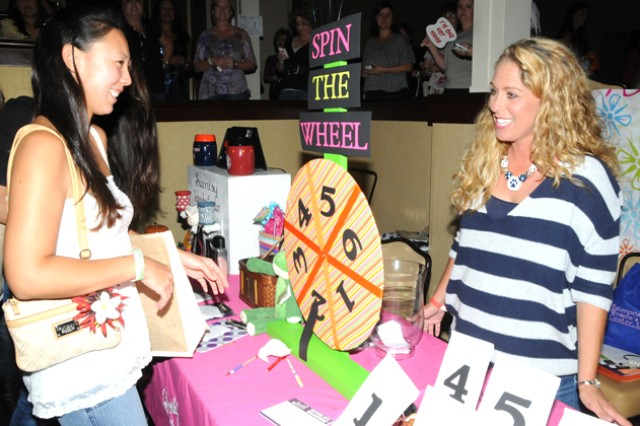 Women window shop at a booth to talk to associates and see what each vendor has to offer at Girls Night Out Sept. 7.