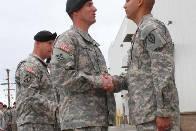 Sgt. Stephen Stoops (right), assigned to the 1st Battalion, 24th Infantry Regiment, was awarded the Bronze Star Medal for Valor, July 23, 2012, by Col. Brian J. Reed (center), for his selfless actions on a small base in southern Afghanistan which saved the lives of two Soldiers in January 2012.