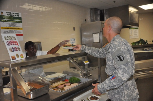 Karin Davis, left, serves Sgt. 1st Class Johnny Goenen a sandwich Tuesday at the U.S. Army Drill Sergeant School's dining facility, which recently was named best Civilian Garrison dining facility in the IMCOM Atlantic region. The next leg of the competition pits the region winners against each other.
