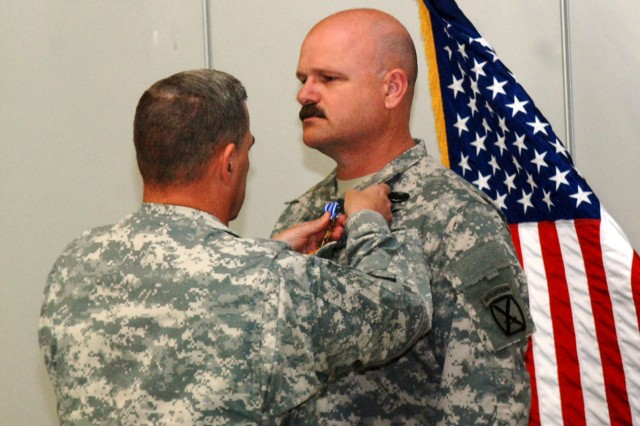 Maj. Gen. Mark A. Milley, Fort Drum and 10th Mountain Division (LI) commander, pins the Distinguished Flying Cross to the uniform of Chief Warrant Officer 4 Kenneth G. Brodhead, a medevac standardization pilot with C Company Dustoff, 3rd General Support Aviation Battalion, 10th Aviation Regiment, 10th Combat Aviation Brigade, during a ceremony Sept. 7, 2012, at Wheeler-Sack Army Airfield on Fort Drum, N.Y. Ten aviators received awards for valor during the ceremony, for heroic actions they performed in Afghanistan in 2010-2011.