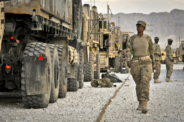 Staff Sgt. Muna Nur, a native of Somalia and a medic with 10th Sustainment Brigade, Task Force Muleskinner, walks a line of vehicles before embarking on a five-day, 400-mile convoy from Bagram Airfield to Forward Operating Base Warrior and back, on Afghanistan's notorious Highway 1.