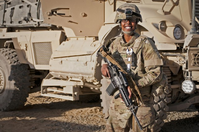 Staff Sgt. Muna Nur, a native of Somalia and a medic 10th Sustainment Brigade, Task Force Muleskinner, laughs with some National Guard Soldiers before embarking with them on a convoy from Forward Operating Base Ghazni to Bagram Airfield, on Afghanistan's notorious Highway 1.