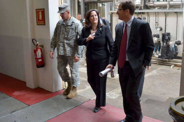 Assistant Secretary of the Army for Installations, Energy and Environment Katherine Hammack (center) tours the Vicenza, Italy, co-generation plant with Col. David Buckingham, USAG Vicenza commander, and Greg Vallery, chief Engineering Division, USAG Vicenza Directorate of Public Works, during her visit to Italy, Sept. 13, 2012.