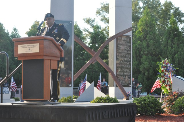 Brig. Gen. Bryan Roberts, Fort Jackson commanding general, speaks during the Evening of Remembrance ceremony Tuesday at the Columbia Metropolitan Convention Center.