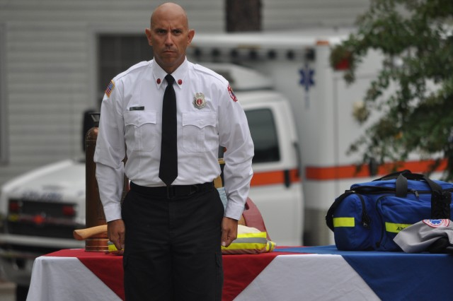 David Hartness, a captain with the Fort Jackson Fire Department represents firefighters during a moment of silence for those who lost their lives in the 9/11 attacks 11 years ago.