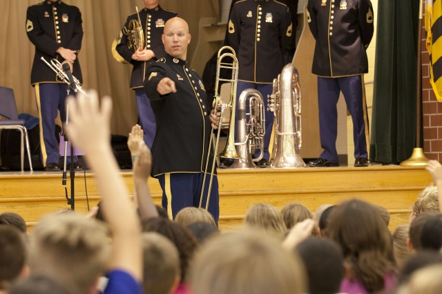 Master Sgt. Aaron, Kadrmas, Concert Band trombone section leader, fields questions from the students of Triadelphia Ridge Elementary School, Sept. 4, 212, during The United States Army Field Band's instrument demonstration class.