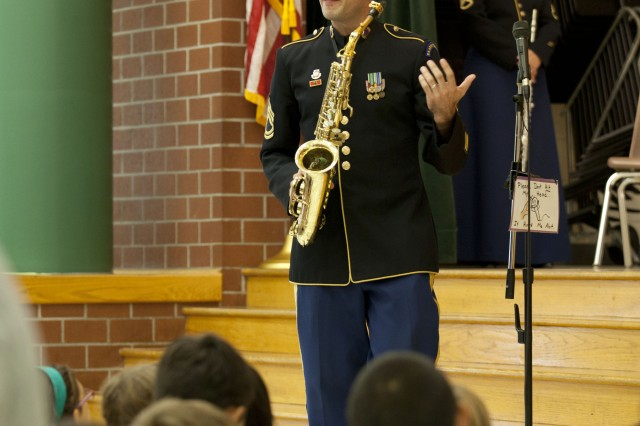 Sgt. 1st Class Brian Sacawa, Concert Band saxophone section leader, talks to the  students of Triadelphia Ridge Elementary School about the saxophone, Sept. 4, 2012.  By having members of The U.S. Army Field Band demonstrate the instruments, students had the chance to see and hear professional musicians perform on instruments the students could learn to play during the school year.