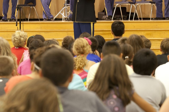 Sgt. 1st Class Harold Yager, Concert Band trumpet, demonstrates the trumpet for the students of Triadelphia Ridge Elementary School, Sept. 4, 2012, during The United States Army Field Band's instrument demonstration class. The demonstrations were for elementary school students who were getting their first glimpse into the world of music education.