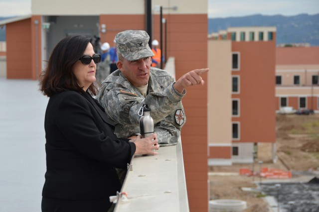 USAG Vicenza Commander, Col. David Buckingham shows Assistant Secretary of the Army for Installations, Energy and Environment Katherine Hammack the progress of construction at Del Din during her visit to Italy, Sept. 13, 2012.