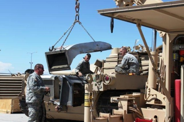 2/1 AD Soldiers provide vehicle and system integration support in preparation for the Network Integration Evaluation 13.1, the fourth iteration in a series of semi-annual, Soldier-driven field exercises designed to further integrate and mature the Army's tactical network, and accelerate the way network technologies are delivered to Soldiers through integrated capability sets of communications gear.