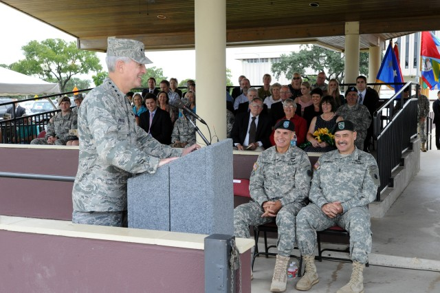 Air Force Gen. Douglas Fraser, the commander of U.S. Southern Command, speaks to attendees of the U.S. Army South change of command ceremony between Maj. Gen. Frederick S. Rudesheim (right), the incoming commanding general of U.S. Army South, and Maj. Gen. Simeon G. Trombitas (center), the outgoing Army South commanding general, during their change of command ceremony Sept. 14 at MacArthur Parade Field at Fort Sam Houston, Texas. (U.S. Army photo by Eric R. Lucero, U.S. Army South Public Affairs)