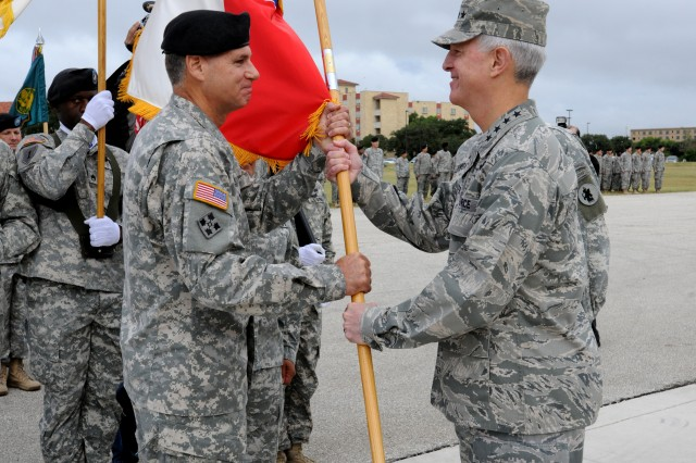 Air Force Gen. Douglas Fraser (right), the commander of U.S. Southern Command, presents the U.S. Army South colors to Maj. Gen. Frederick S. Rudesheim, the incoming Army South commanding general, during a change of command ceremony Sept. 14 at MacArthur Parade Field at Fort Sam Houston, Texas. (U.S. Army photo by Eric R. Lucero, U.S. Army South Public Affairs)