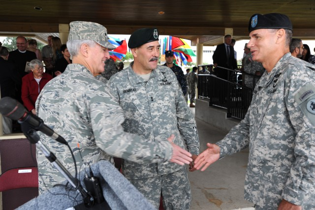 Air Force Gen. Douglas Fraser (left), the commander of U.S. Southern Command, shakes hands with Maj. Gen. Frederick S. Rudesheim (right), the incoming commanding general of U.S. Army South, while Maj. Gen. Simeon G. Trombitas (center), outgoing Army South commanding general, after their change of command ceremony Sept. 14 at MacArthur Parade Field at Fort Sam Houston, Texas.