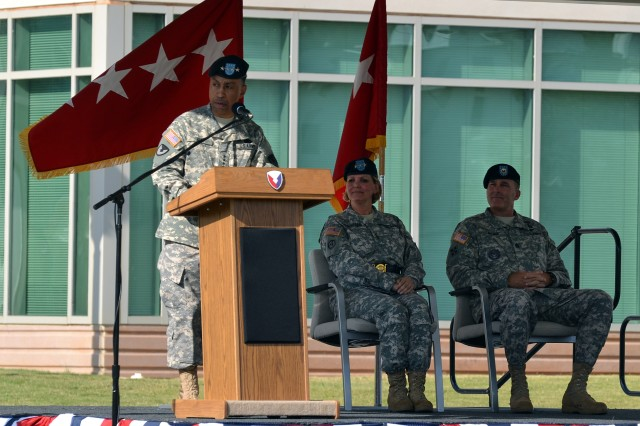 Gen. Dennis  L. Via, AMC Commander (left), speaks to the workforce during the Sept. 14, 2012 Welcome Ceremony for Lt. Gen. Patricia E. McQuistion(center), AMC's Deputy Commanding General, while AMC Command Sergeant Major Ronald Riling looks on.