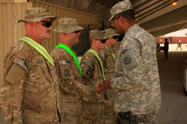 Lt. Gen. Vincent Brooks, Third Army commander, recognizes Soldiers of the Bagram Airfield,Afghanistan, Retrograde Sort Yard and presents each of them with coins.