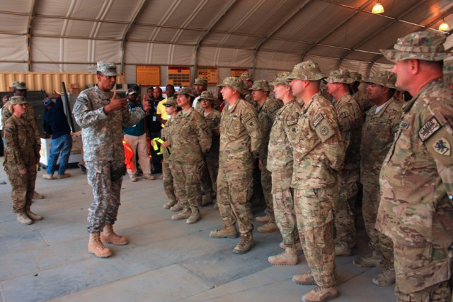 Lt. Gen. Vincent Brooks, Third Army commander, ends his trip congratulating Soldiers of the Retrosort Yard at Bagram Airfield, Afghanistan, for a job well done.
