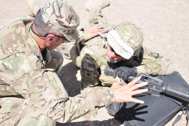The 25th Combat Aviation Brigade Command Sgt. Maj. Jesus Ruiz explains the importance of memorizing the 9-line MEDEVAC to Spc. Gregory Waggoner, 3rd Battalion, 158th Aviation Regiment, 25th CAB, during Personnel Recovery Team training at Forward Operating Base Shindand, Afghanistan, Sept. 11.
