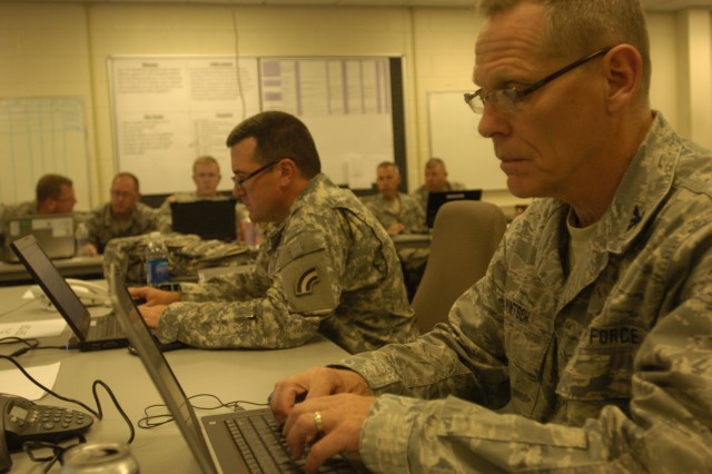 Air National Guard Col. Walter Wintsch and New York National Guard Col. Dennis Deely work together in the operations center at the forefront of a hurricane relief exercise, Sept. 14, 2012, in Troy, N.Y. Wintsch, the Joint Force 4 Commander during the exercise, and Deely, the operations officer during the exercise, worked together with members of the National Guard, Air National Guard, New York Guard and New York Naval Militia during the exercise.