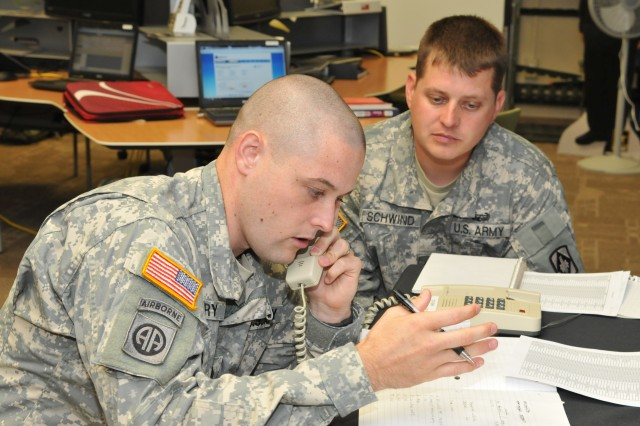 Army Recruiter Course students Sgt. James Story and Staff Sgt. Jeffery Schwind call prospects from actual lead lists (lists are typically provided by center commander course students from their stations).