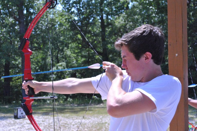 Thomas Johnson tries out his skills at archery during the 2012 Central Region YLF at Fort Leonard Wood, Mo.