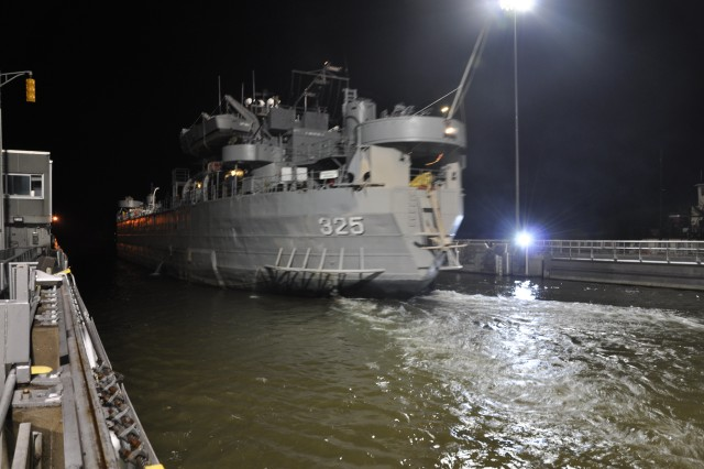The 69-year-old Landing Ship Tank 325 enters Cheatham Lake at 2 AM, Sept. 17, 2012 having become the first LST in history to pass through the U.S. Army Corps of Engineers Nashville District's Cheatham Lock at Ashland City, Tenn. Commissioned Feb. 1, 1943 the USS LST 325 saw extensive combat duty in the European Theater in World War II; service with the Military Sea Transportation Service as USNS L...ST 325 during arctic operations in the 1950's and later as L-144 (A/G Syros) while in the service of the Greek Navy. The USS LST Memorial, Inc. obtained the ship in 2000 and will offer public tours of the now fully operational World War II-era ship Sept. 18-24, at Nashville's Riverfront Park. (USACE photo by Fred Tucker)See More