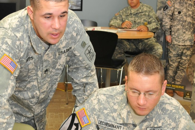 Staff Sgt. Aaron Hess, an assistant recruiting center commander in Farmington, Mo., gives guidance to Army Recruiter Course student Sgt. Derek Lecheminant, now assigned to Sacramento Recruiting Battalion. Course facilitator Sgt. 1st Class Rex Allen observes. Graduates feel the course interaction is beneficial to all students.