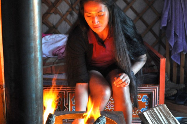 Cadet Asenati Petelo, of the University of Hawaii, built a fire in the wood burning stove inside her Gur. The temperatures dropped into the low 40s at night and the fires were necessary to keep the Cadets warm. It was a good way for them to learn how local people still live.