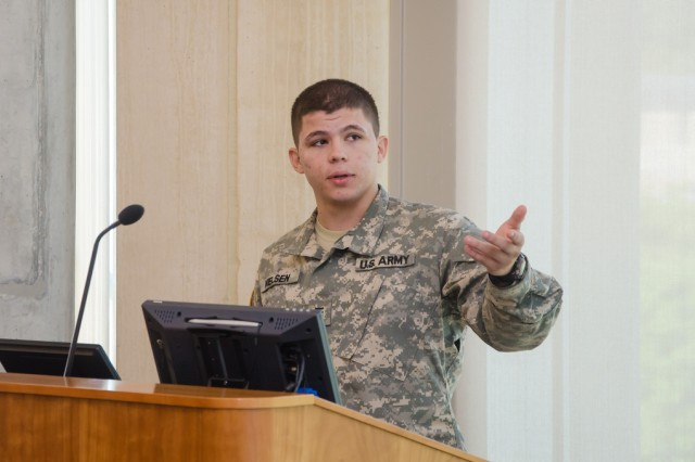 Cadet Jeffrey Nielsen briefs U.S. Army Research, Development and Engineering Command officials on his summer project, Sept. 11, 2012.