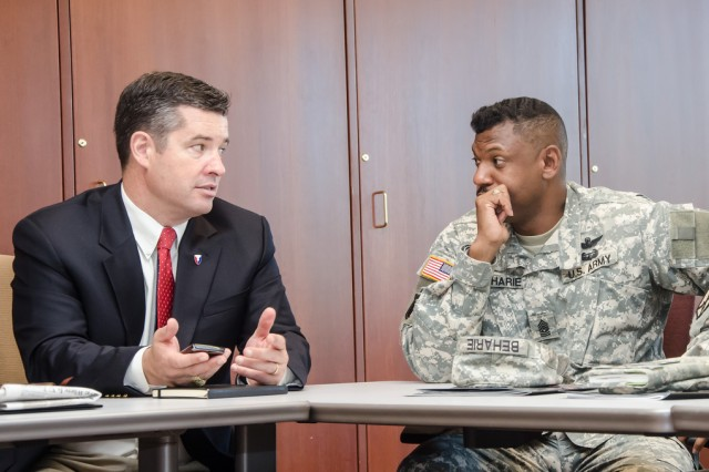 U.S. Army Research, Development and Engineering Command Director Dale A. Ormond (left) speaks with Command Sgt. Maj. Lebert Beharie at the U.S. Military Academy, Sept. 11, 2012.