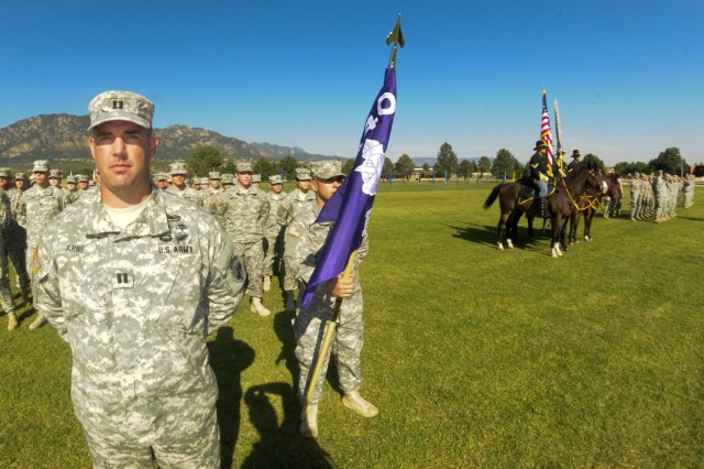Soldiers of the 440th Civil Affairs Battalion stand together during a historic unit activation at Fort Carson, Colo., Sept. 15, 2012.