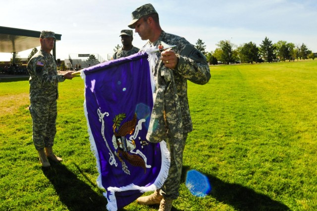 Col. Steven J. Ford and Command Sgt. Maj. Aaron Miller unfurl the 440th Civil Affairs Battalionn's colors at Fort Carson, Colo., Sept. 15, 2012.