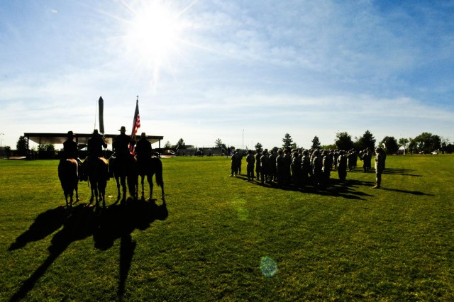 Fort Carson's mounted color guard stands alongside Soldiers from the 440th Civil Affairs Battalion at Fort Carson, Colo., Sept. 15, 2012.