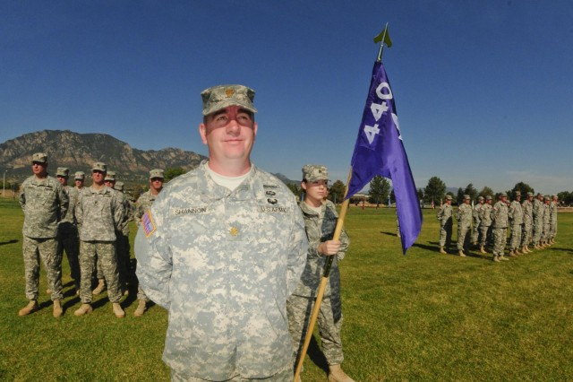 Soldiers of the 440th Civil Affairs Battalion stand together during a historic unit stand-up at Fort Carson, Colo., Sept. 15, 2012.