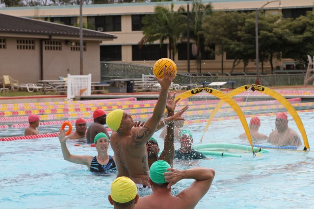 Marine Cpl. Bryson Walker, Wounded Warrior Battalion-West catches the ball during an adaptive water polo tournament held at Richardson Pool, at Schofield Barracks, Hawaii, Sept. 7, 2012. The tournament was sponsored by the Pacific Regional Medical Command's Warrior Transition Battalion.