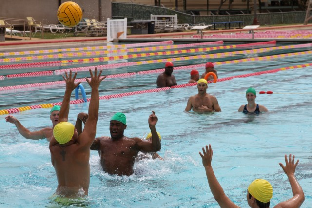 Soldiers from the Pacific Regional Medical Command's Warrior Transition Battalion (green caps) engage in some friendly competition against Marines (yellow caps) from the Wounded Warrior Battalion-West, stationed at Kaneohe Bay, in an adaptive water polo tournament held at Richardson Pool, at Schofield Barracks, Hawaii, Sept. 7, 2012.
