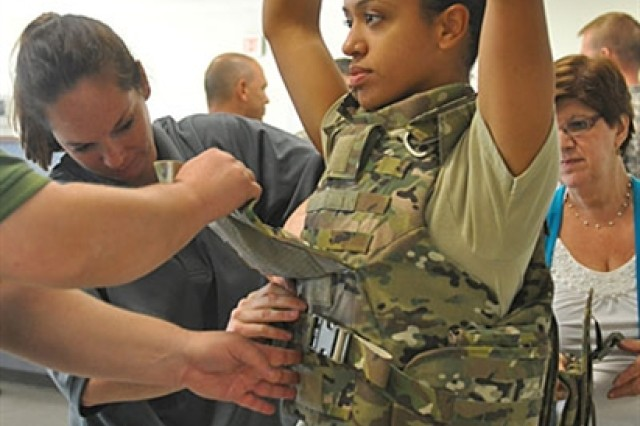 Spc. Gilliann Campbell gets strapped into her female body armor for prototype testing at Fort Campbell, Ky.