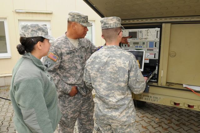 GRAFENWOEHR,  Germany (Sept. 13, 2012) - Sgt. Steven L. Galimore (Middle) instructs Pfc. Tanner L. Shockley (Right) and Spc. Jessica Jamerson (Left) on the various aspects of the satellite transport terminal (STT) during Combined Endeavor.  Soldiers from 44th Expeditionary Signal Battalion gain valuable hands on experience during exercises like Combined Endeavor. (Photo by Sgt. Brian Rodan, 5th Signal Command)