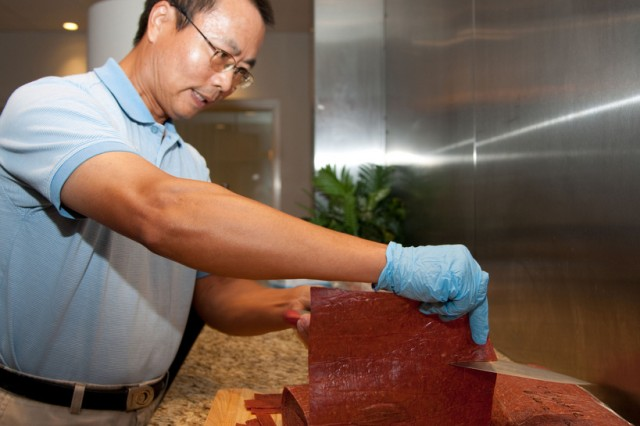 Cutting a sample of osmotically dehydrated meat is Xingchu Li, a food scientist with FPL Foods. As the largest integrated food processing company in the Southeast, FPL Foods is in tune with what the DOD is trying to develop. Li, from China, completed his doctorate in food science at Iowa State University.