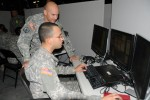 Soldiers training on Mission Command systems in garrison