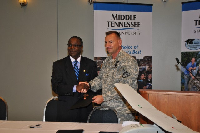 Middle Tennessee State University President, Dr. Sidney A. McPhee, shakes hands with COL Tim Baxter, UAS Project Manager, after announcing a partnership between the Army and the University.