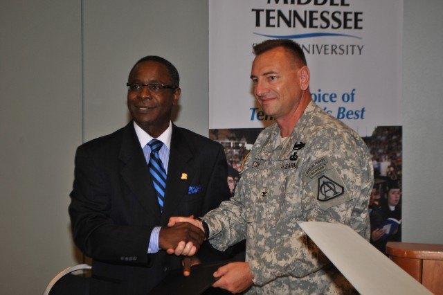 Middle Tennessee State University President, Sidney A. McPhee, shakes hands with Col. Tim Baxter, UAS project manager, after announcing a partnership between the Army and the University.