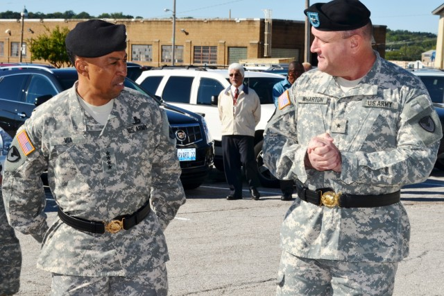 Gen. Dennis L. Via, commanding general, Army Materiel Command and Brig. Gen. John F. Wharton, incoming ASC commanding general, share a light moment before the assumption of command ceremony. (Photo by Galen Putnam, ASC Public Affairs)